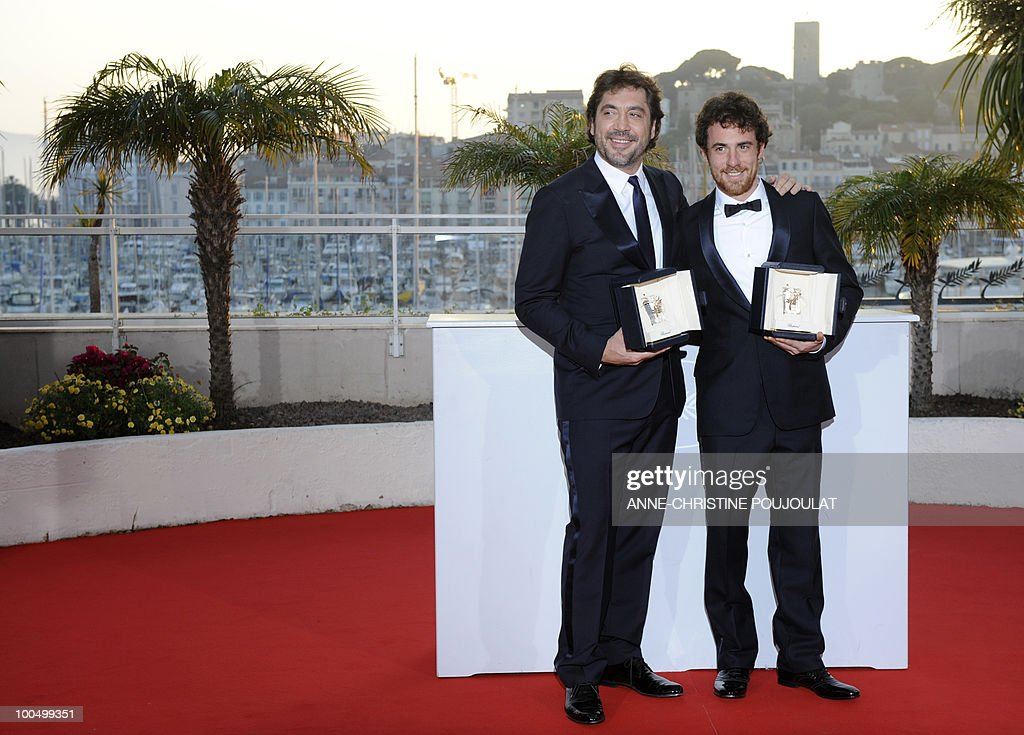 Italian actor Elio Germano and Spanish actor Javier Bardem (L) pose after sharing the Best Actor award during the photocall of the closing ceremony at the 63rd Cannes Film Festival on May 23, 2010 in Cannes