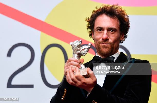 Italian actor Elio Germano winner of the Silver Bear for Best Actor poses with his trophy ahead a press conference after the awarding ceremony of the...