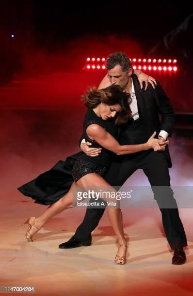 Italian actor Enrico Lo Verso and his dance partner Samanta Togni perform on the Italian TV show 'Ballando Con Le Stelle' at RAI Auditorium on May 03...
