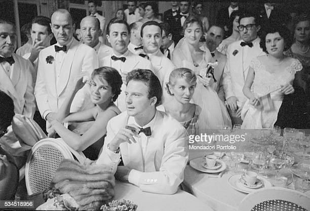 Italian actor Franco Interlenghi and his wife Italian actress Antonella Lualdi sitting a the table during the XVIII Venice International Film...