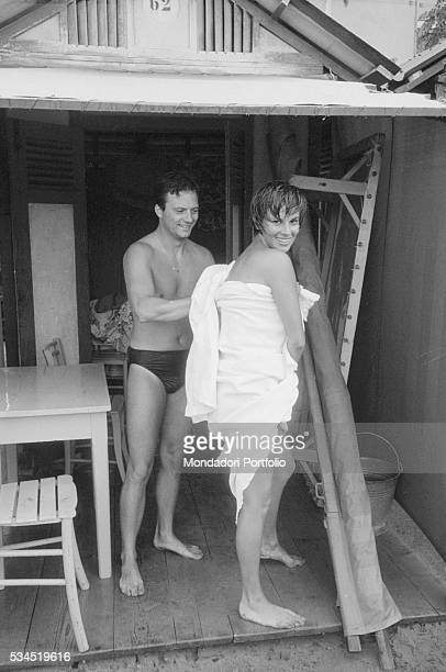 Italian actor Franco Interlenghi and his wife Italian actress Antonella Lualdi drying on the beach during the XVIII Venice International Film...