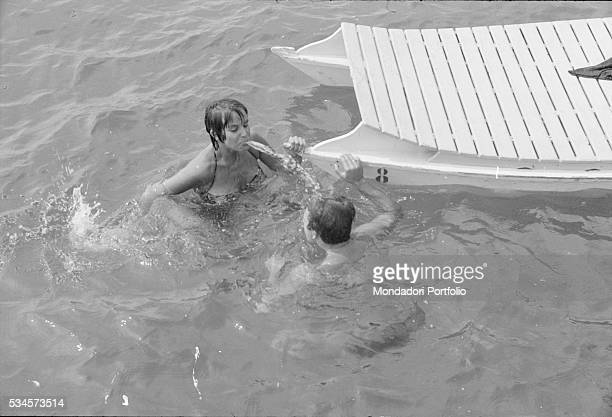 Italian actor Franco Interlenghi and his wife Italian actress Antonella Lualdi joking in the sea during the XVIII Venice International Film Festival...