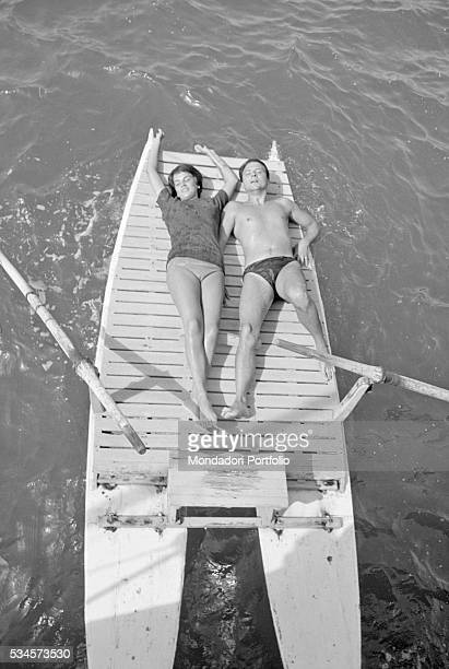 Italian actor Franco Interlenghi and his wife Italian actress Antonella Lualdi relaxing on a boat during the XVIII Venice International Film Festival...
