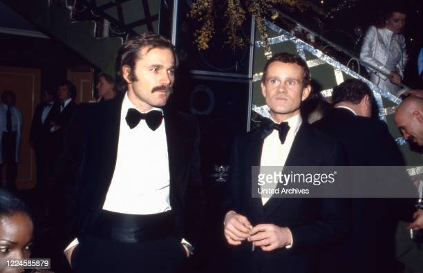 Italian actor Franco Nero with actor Werner Pochath Germany 1980s
