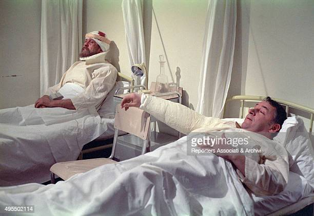 Italian actor Gastone Moschin and French actor Philippe Noiret acting as wounded men at the hospital in the film My Friends 1975