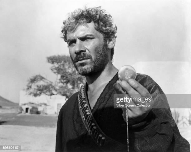 Italian actor Gian Maria Volontè as El Indio holding a musical pocket watch in the spaghetti western 'Per qualche dollaro in più' 1965