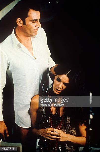 Italian actor Gian Maria Volonté grabbing Brazilian actress Florinda Bolkan 's hair in the film Investigation of a Citizen Above Suspicion 1970