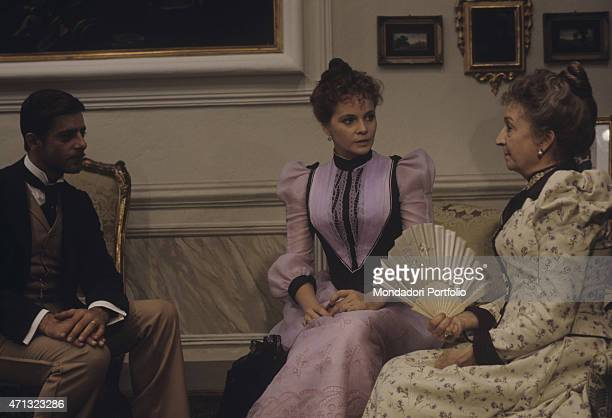 Italian actor Giancarlo Giannini and Italian actresses Laura Antonelli and Rina Morelli sitting in the livingroom of a villa nearby Lucca in the film...