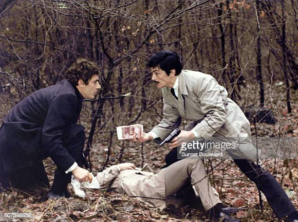 Italian actor GianMaria Volonte and French actor Alain Delon on the set of Le Cercle Rouge written and directed by JeanPierre Melville
