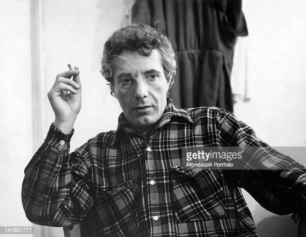 Italian actor Gianrico Tedeschi smoking a cigarette 1956