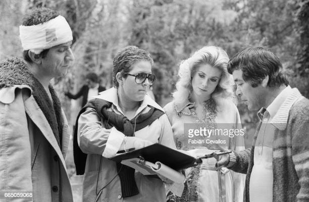 Italian actor Gigi Proietti and French actress Catherine Deneuve on the set of the 1977 Italian film Casotto directed by Sergio Citti The film also...