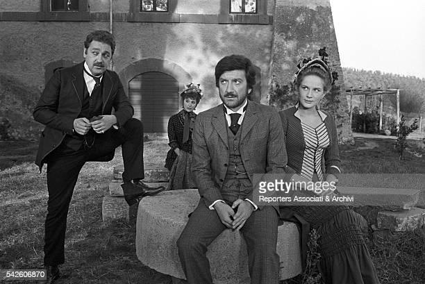 Italian actor Gigi Proietti French actress Dominique Sanda and Italian actor Paolo Bonacelli in The Inheritance 1976