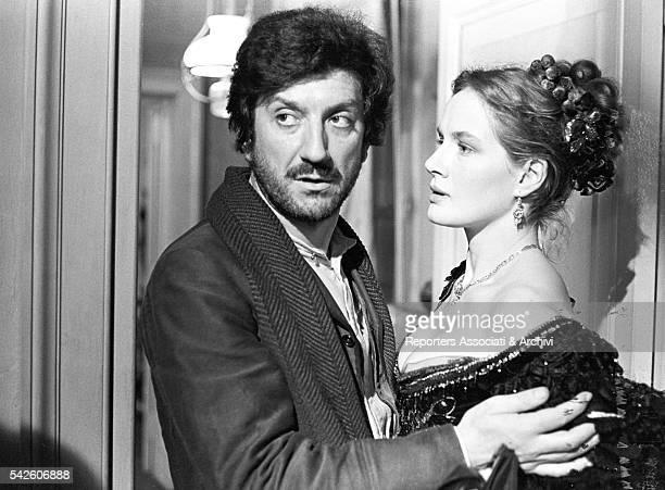Italian actor Gigi Proietti holding French actress Dominique Sanda in The Inheritance 1976