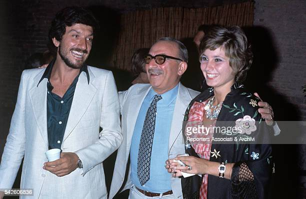 Italian actor Gigi Proietti, Italian director Alberto Lattuada and Italian actress Lina Polito loughing together. Taormina, August 1974