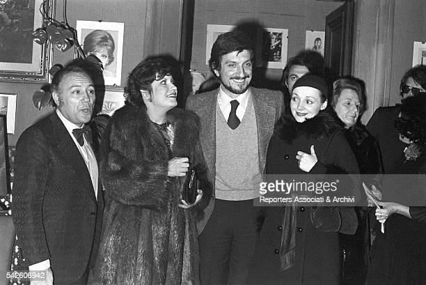 Italian actor Gigi Proietti Italian singer Claudio Villa french actress AndrŽa FerrŽol and Italian actress Milena Vukotic in the Morazzani salon for...