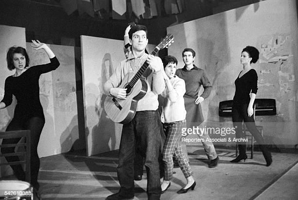 Italian actor Gigi Proietti playing a guitar and Italian actor and director Giancarlo Cobelli in the theater play Can Can degli italiani in...