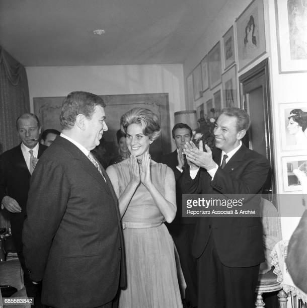 Italian actor Gino Cervi and Italian actress Alida Valli attending a party at Italian cinema critic Gian Luigi Rondi's home beside them in this...