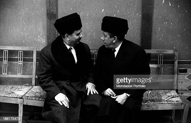 Italian actor Gino Cervi looking into the eyes French actor comedian and singer Fernandel in the film Don Camillo in Moscow Brescello 1965