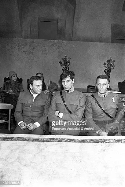 Italian actor Giuliano Gemma and French actors Laurent Terzieff and JeanLouis Trintignant sitting on the set of the film The Desert of the Tartars...