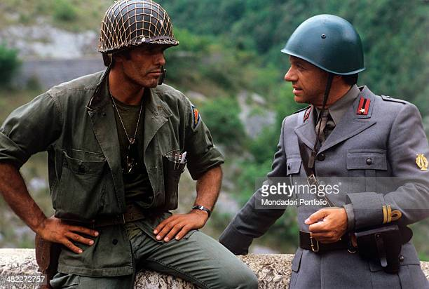 Italian actor Giuliano Gemma and Italian actor and singer Johnny Dorelli playing the role of soldiers acting in the film The Odd Squad. 1982