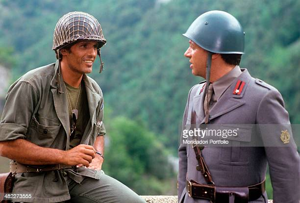 Italian actor Giuliano Gemma and Italian actor and singer Johnny Dorelli playing the role of soldiers acting in the film The Odd Squad 1982