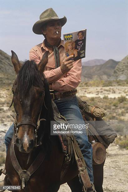 """Italian actor Giuliano Gemma reading the magazine Ciak on the set of the film Tex and the Lord of the Deep. Italy, 1985 """