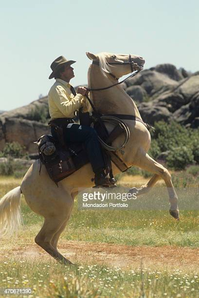 """Italian actor Giuliano Gemma riding a white horse on the set of the film Tex and the Lord of the Deep. Italy, 1985 """
