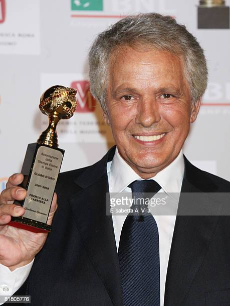 "Italian actor Giuliano Gemma shows his award at the career during the 2008 ""Globo D`Oro"" Awards held Villa Massimo on July 2, 2008 in Rome, Italy...."