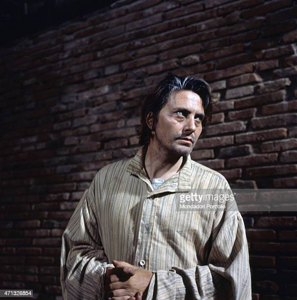 Italian actor Giulio Brogi acting dressed as a prisonner in the film St Michael Had a Rooster 1972