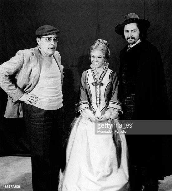 Italian actor Giulio Brogi and Italian actress Giulietta Masina born Giulia Anna Masina pose in stage costume with Silverio Blasi the director of the...