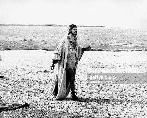 Italian actor Giulio Brogi is shot on the seashore dressed in stage costumes during the making of the TV miniseries Eneide in which he plays the role...