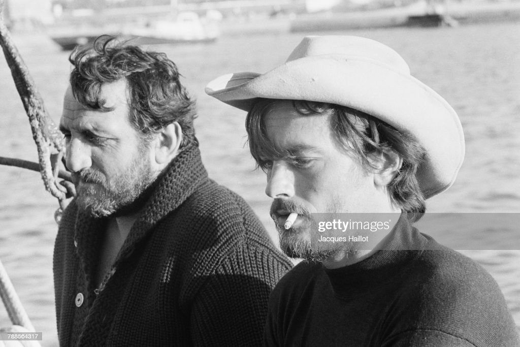 Italian actor Lino Ventura and French actor Alain Delon on the set of Les aventuriers, written and directed Robert Enrico.