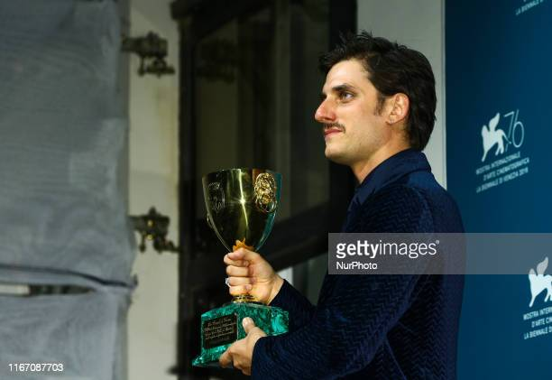 Italian actor Luca Marinelli holds the Coppa Volpi for Best Actor he received for the movie quotMartin Edenquot during the awards ceremony winners...