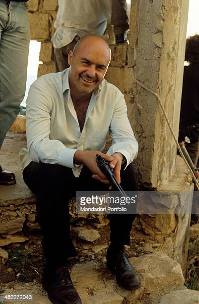 Italian actor Luca Zingaretti smiling during a break in the shooting of the TV series Inspector Montalbano Sicily 2000