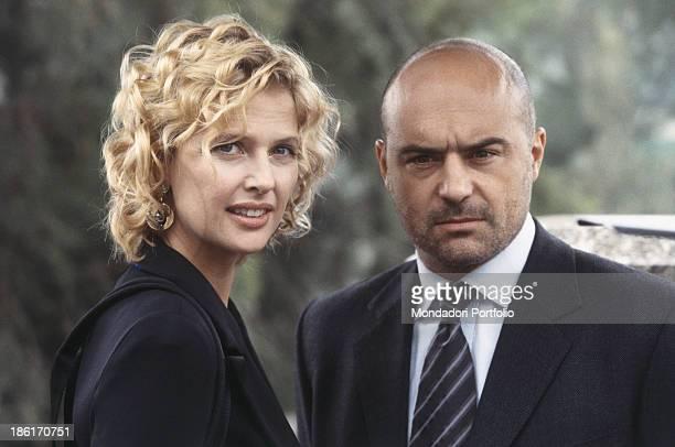 Italian actor Luca Zingaretti standing beside Austrian actress Katharina Boehm in the TV miniseries Inspector Montalbano Sicily 2000