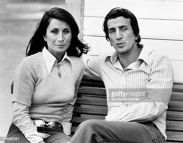 Italian actor Luigi Vannucchi sitting on a bench with his wife Franca Cuoghi Rome 1970s