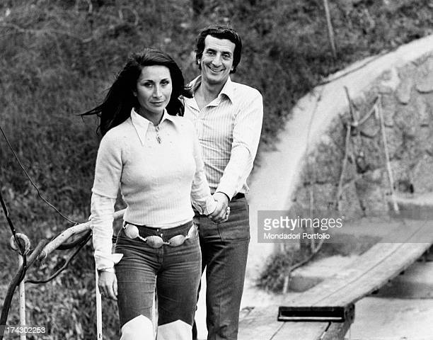 Italian actor Luigi Vannucchi walking hand in hand with his wife Franca Cuoghi Rome 1970s