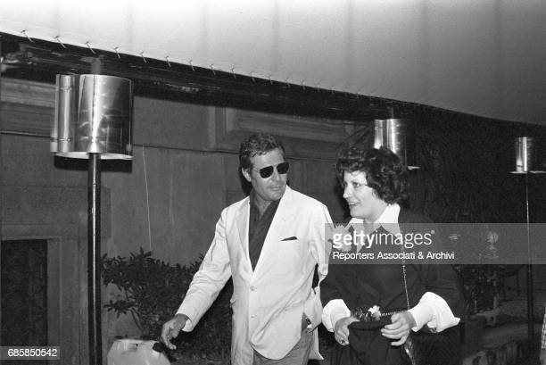 Italian actor Macello Mastroianni and French actress Andr'a Ferr'ol coming out of a club Rome 1975