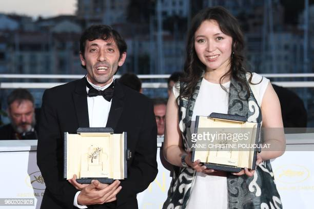 Italian actor Marcello Fonte and Kazakh actress Samal Yeslyamova pose with their trophies on May 19 2018 during a photocall after they won the Best...