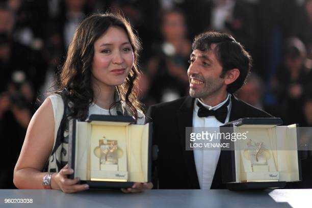 TOPSHOT Italian actor Marcello Fonte and Kazakh actress Samal Yeslyamova pose with their trophies on May 19 2018 during a photocall after they won...