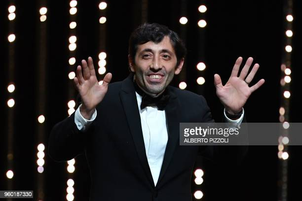 Italian actor Marcello Fonte celebrates after he was awarded with the Best Actor Prize for his part in the film 'Dogman' on May 19 2018 during the...