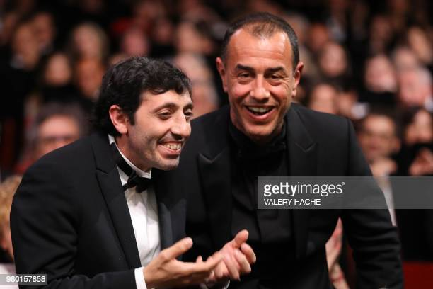 Italian actor Marcello Fonte celebrates with Italian director Matteo Garrone after he was awarded with the Best Actor Prize for his part in the film...
