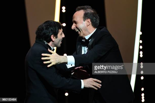 Italian actor Marcello Fonte celebrates with Italian director Roberto Benigni after he was awarded with the Best Actor Prize for his part in the film...