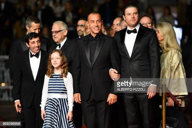Italian actor Marcello Fonte Italian actress Alida Baldari Calabria Italian director Matteo Garrone and Italian actor Edoardo Pesce pose as they...