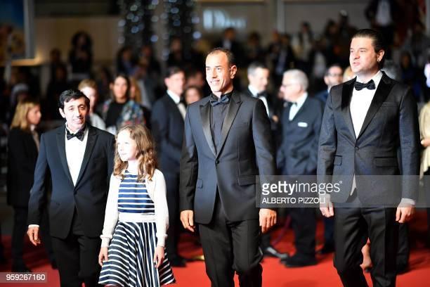 Italian actor Marcello Fonte Italian actress Alida Baldari Calabria Italian director Matteo Garrone and Italian actor Edoardo Pesce arrive on May 16...