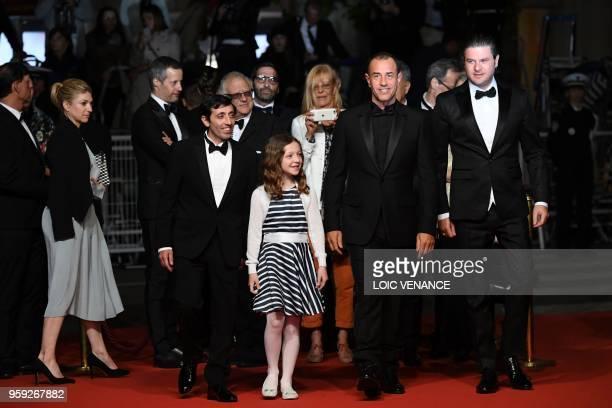 Italian actor Marcello Fonte Italian director Matteo Garrone Italian actor Edoardo Pesce and Italian actress Alida Baldari Calabria arrive on May 16...