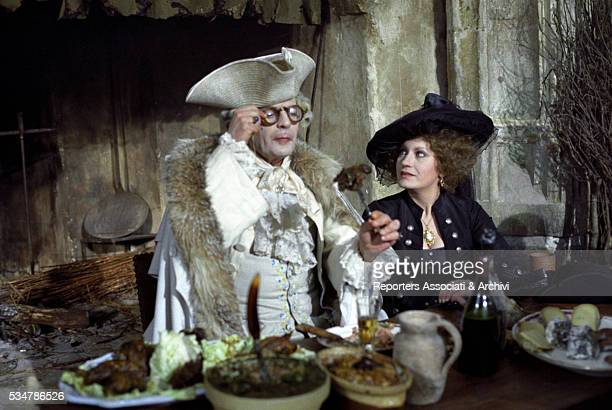 Italian actor Marcello Mastroianni acting Giacomo Casanova and German actress Hanna Schygulla sitting at the table in the film That Night in Varennes...