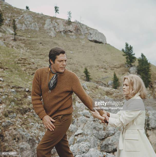 Italian actor Marcello Mastroianni and American actress Faye Dunaway pictured together during shooting of a scene from the film 'A Place for Lovers'...