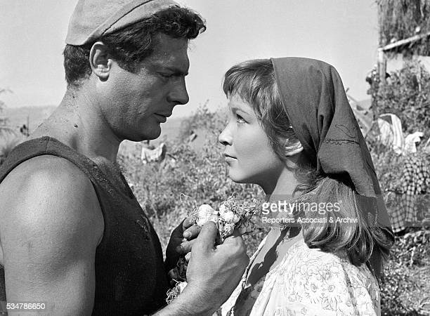 Italian actor Marcello Mastroianni and French actress Marina Vlady looking into each other eyes in the film Days of Love 1953