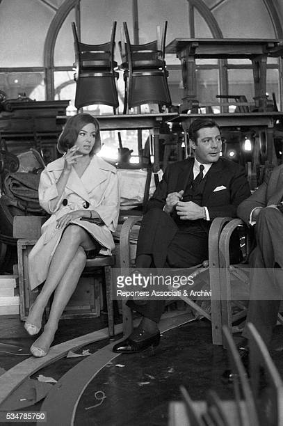Italian actor Marcello Mastroianni and French actress Michèle Mercier relaxing during a break on the set of the film Casanova '70 November 1964